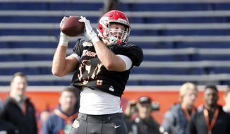 North tight end Adam Trautman of Dayton catches a pass during practice for the Senior Bowl Wednesday, Jan. 22, 2020, in Mobile, Ala. (AP Photo/Butch Dill) ** FILE **
