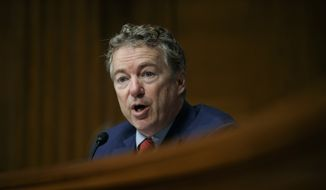 In this March 5, 2019, file photo, Sen. Rand Paul, R-Ky., speaks during a Senate Committee on Health, Education, Labor, and Pensions hearing on Capitol Hill in Washington. Paul said Tuesday, April 7, 2020, that he has recovered from the coronavirus and has started volunteering at a hospital in his Kentucky hometown. The Republican lawmaker tested positive for the virus in March, becoming the first case of COVID-19 in the Senate. (AP Photo/Carolyn Kaster, File)