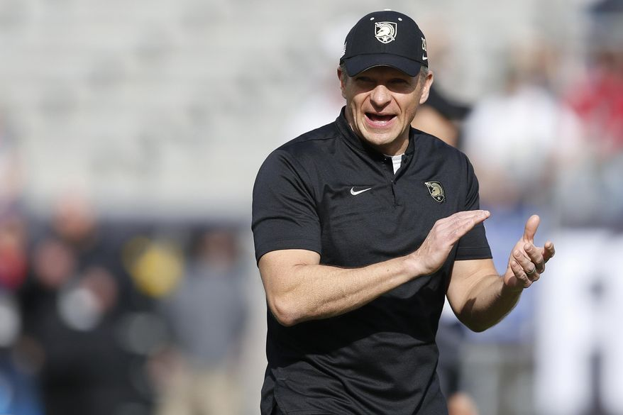 FILE - In this Dec. 22, 2018, file photo, Army head coach Jeff Monken watches as his team warms up before they play Houston in the Armed Forces Bowl NCAA college football game, in Fort Worth, Texas. Monken says his Black Knights are coping with the cancellation of spring ball because of the novel coronavirus. (AP Photo/Jim Cowsert, File)