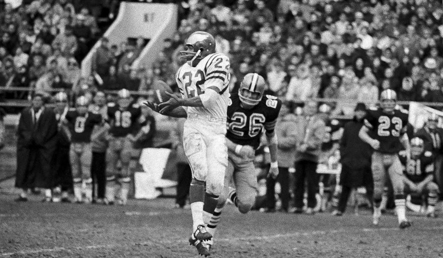 FILE - In this Nov. 20, 1967, file photo, Philadelphia Eagles' Timmy Brown (22) back leaps for a pass from quarterback Norm Snead against New Orleans Saints defensive back Jimmy Heidel (26) in the first half of an NFL football game in Philadelphia. Brown, a running back and kick returner who won an NFL championship with the Eagles in 1960, has died. He was 82. The Eagles announced Tuesday, April 7, 2020, that Brown passed away on Saturday. (AP Photo/Bill Ingraham, File)