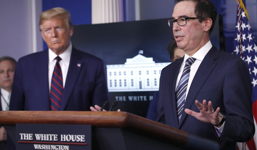 President Donald Trump listens as Treasury Secretary Steven Mnuchin speaks about the coronavirus in the James Brady Press Briefing Room of the White House, Thursday, April 2, 2020, in Washington. (AP Photo/Alex Brandon)
