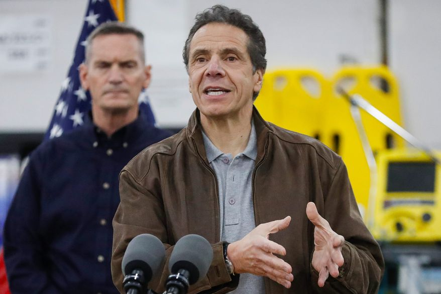 In this file photo, New York Gov. Andrew Cuomo speaks during a news conference at the Jacob Javits Center on , Monday, March 23, 2020, in New York. (AP Photo/John Minchillo) ** FILE **