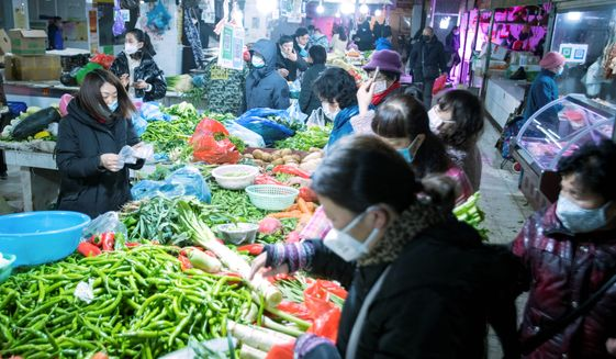 A market in Wuhan, China, has been widely reported to be the origin of the outbreak of a bat virus that erupted into a pandemic, but the market in question does not sell bats. (Associated Press)