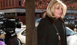 FILE - In this Dec. 14, 1998 file photo Linda Tripp arrives at the offices of Judicial Watch, a public interest law firm, in Washington to give a deposition in a lawsuit about the FBI files controversy. Tripp, whose secretly recorded conversations with White House intern Monica Lewinsky led to the 1998 impeachment of President Bill Clinton, died Wednesday, April 8, 2020, at age 70. (AP Photo/Dennis Cook, File)