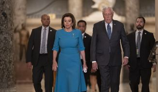 In this March 13, 2020, photo, Speaker of the House Nancy Pelosi, D-Calif., and Majority Leader Steny Hoyer, D-Md., arrive to make a statement ahead of a planned late-night vote on the coronavirus aid package deal, at the Capitol in Washington. (AP Photo/J. Scott Applewhite) **FILE**
