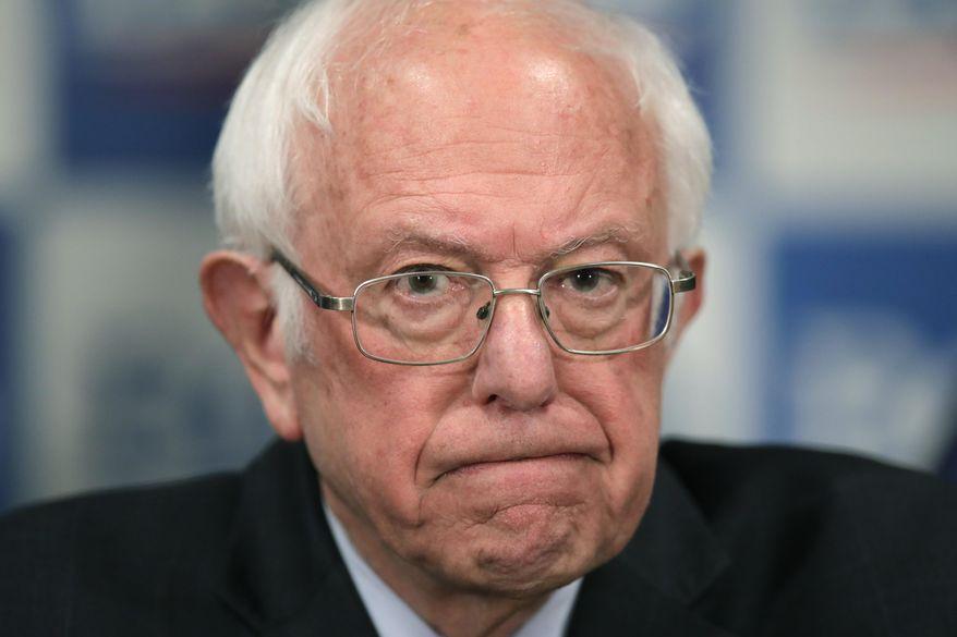 Democratic presidential candidate, Sen. Bernie Sanders, I-Vt., speaks to reporters about coronavirus in Burlington, Vermont, March 12, 2020. (AP Photo/Charles Krupa) ** FILE **