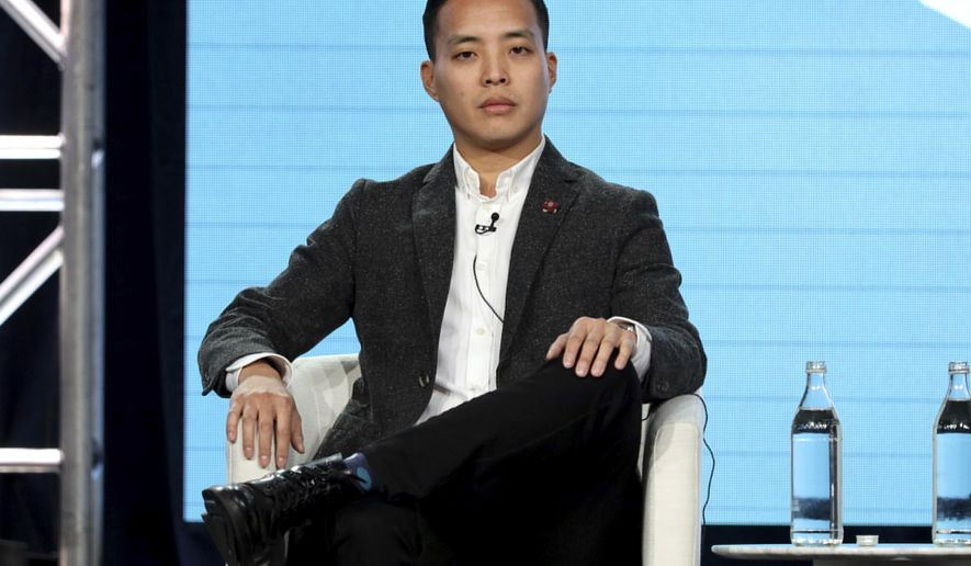"""FILE - This Jan. 19, 2020 file photo shows Alan Yang during the Apple+ TCA 2020 Winter Press Tour in Pasadena, Calif. Yang makes his feature directorial debut with """"Tigertail,"""" on Netflix Friday, which is loosely based on his father's immigration story. (Photo by Willy Sanjuan/Invision/AP, File)"""
