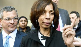 Former Baltimore mayor Catherine Pugh and her attorney Steven Silverman, left, leave a sentencing hearing at U.S. District Court in Baltimore on Thursday, Feb. 27, 2020. Pugh was sentenced to three years in federal prison for arranging fraudulent sales of her self-published children's books to nonprofits and foundations to promote her political career. (AP Photo/Steve Ruark)