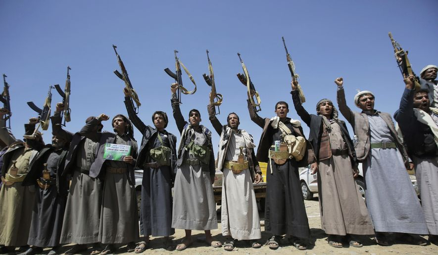 In this Saturday, Sept. 21, 2019, file photo, Shiite Houthi tribesmen hold their weapons as they chant slogans during a tribal gathering showing support for the Houthi movement, in Sanaa, Yemen. On Wednesday, April 8, 2020, the Saudi-led coalition fighting the Iranian-backed Houthi rebels in Yemen announced that its forces would begin a cease-fire starting at midnight, in what could pave the way for the first direct peace talks between the two sides that have been at war for more than five years. (AP Photo/Hani Mohammed) ** FILE **