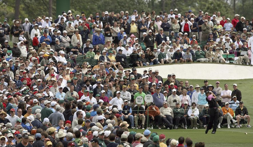 FILE - In this April 5, 2007, file photo, Tiger Woods hits from the third tee during the first round of the Masters golf tournament at Augusta National Golf Club in Augusta, Ga. For the first since a three-year suspension caused by World War II, this tradition unlike any other won't be held in its usual slot on the calendar, where it serves as sort of an unofficial kickoff to spring. (Curtis Compton/Atlanta Journal-Constitution via AP, File)