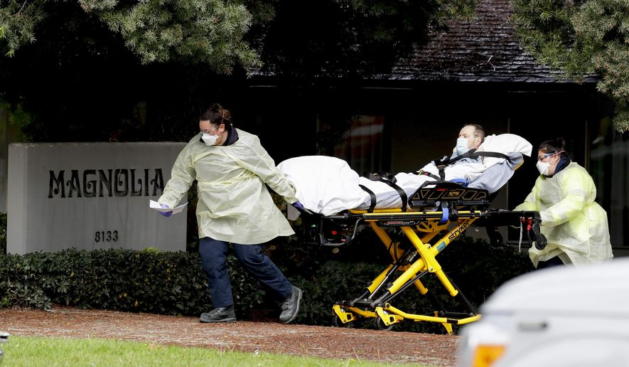 A patient is evacuated from the Magnolia Rehabilitation and Nursing Center in Riverside, Calif., Wednesday, April 8, 2020. More than 80 patients from a Riverside skilled nursing facility are being evacuated this morning to other healthcare locations throughout Riverside County, Calif. (AP Photo/Chris Carlson)