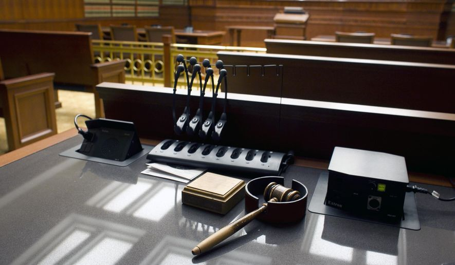 This Jan. 14, 2013, file photo shows a gavel sitting on a desk inside a courtroom.  (AP Photo/Brennan Linsley, File) **FILE**