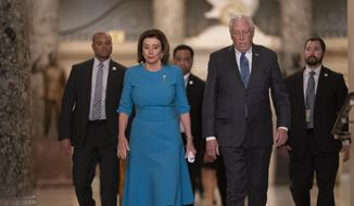 In this March 13, 2020, file photo, Speaker of the House Nancy Pelosi, D-Calif., and Majority Leader Steny Hoyer, D-Md., arrive to make a statement ahead of a planned late-night vote on the coronavirus aid package deal, at the Capitol in Washington. (AP Photo/J. Scott Applewhite, File)