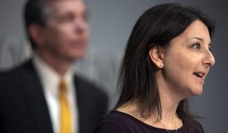 Dr. Mandy Cohen, Secretary of the North Carolina Department of Health and Human Services answers questions about the spread of the COVID-19 virus in a skilled nursing facility in Orange County during a press briefing on Wednesday, April 8, 2020, in Raleigh, N.C. (Robert Willett/The News & Observer via AP)