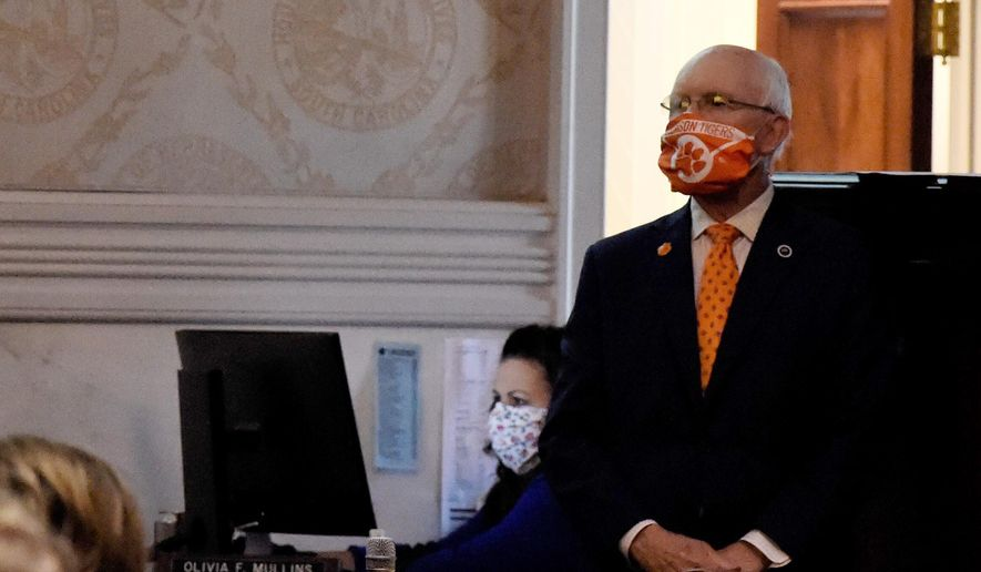 State Rep. Gary Clary wears a face mask he made from a Clemson University banner during a special, one-day session of the South Carolina Legislature on Wednesday, April 8, 2020, in Columbia, S.C. This year's session has been paused for several weeks amid the new coronavirus outbreak. (AP Photo/Meg Kinnard)
