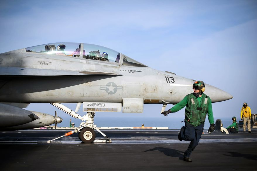 ARABIAN GULF (Feb. 12, 2018) An F/A-18F Super Hornet assigned to the Fighting Redcocks of Strike Fighter Attack Squadron (VFA) 22 readies for launch on the flight deck of the aircraft carrier USS Theodore Roosevelt (CVN 71).  (U.S. Navy photo)