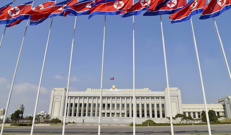 North Korean flags flutter in front of the Presidium of the Supreme People's Assembly building in Pyongyang, Thursday, April 9, 2020. North Korea's parliament, the Supreme People's Assembly, is scheduled to convene on April 10. (Kyodo News via AP)