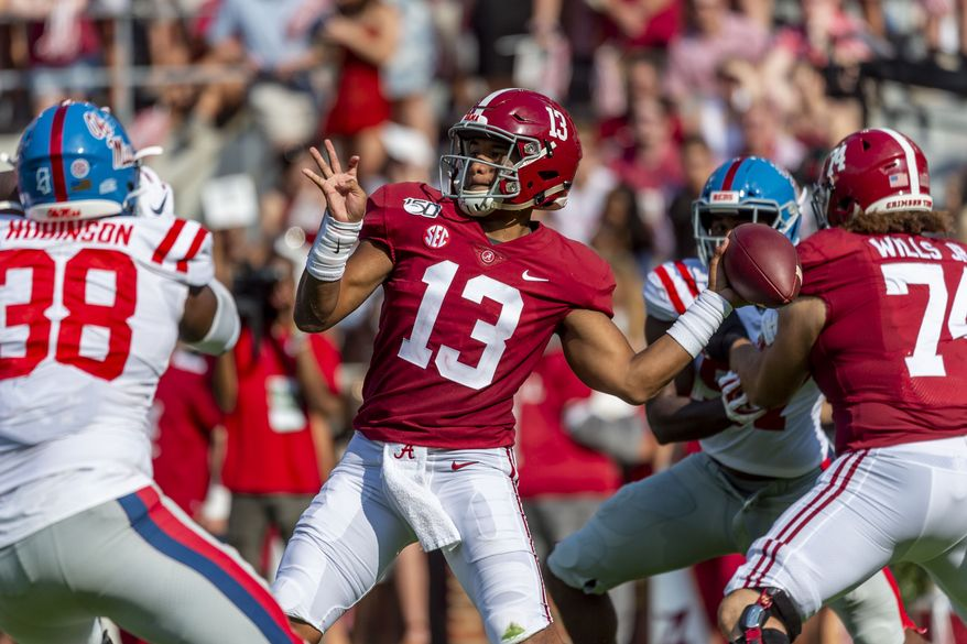 FILE - In this Sept. 28, 2019, file photo, Alabama quarterback Tua Tagovailoa (13) throws a pass during the first half of the team's NCAA college football game against Mississippi in Tuscaloosa, Ala. Tagovailoa's agent says the quarterback is healthy and will be ready for training camp. Tagovailoa held a virtual pro day with former NFL quarterback Trent Dilfer on Thursday, April 9, after the former Alabama star's personal pro day was canceled because of the coronavirus outbreak. Tagovailoa injured his hip on Nov. 15 and had season-ending surgery two days later. He is expected to be among the top five picks in the NFL draft later this month. (AP Photo/Vasha Hunt, File)
