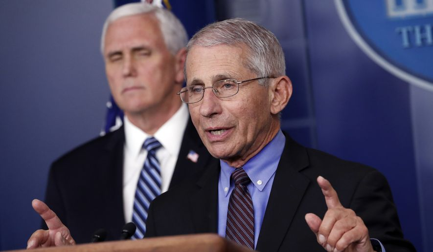 Dr. Anthony Fauci, director of the National Institute of Allergy and Infectious Diseases, speaks about the coronavirus in the James Brady Press Briefing Room of the White House, Thursday, April 9, 2020, in Washington, as Vice President Mike Pence listens. (AP Photo/Andrew Harnik)