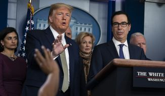 In this March 17, 2020, file photo Treasury Secretary Steven Mnuchin, right, listens as President Donald Trump speaks during a press briefing with the coronavirus task force, at the White House in Washington. (AP Photo/Evan Vucci) ** FILE **
