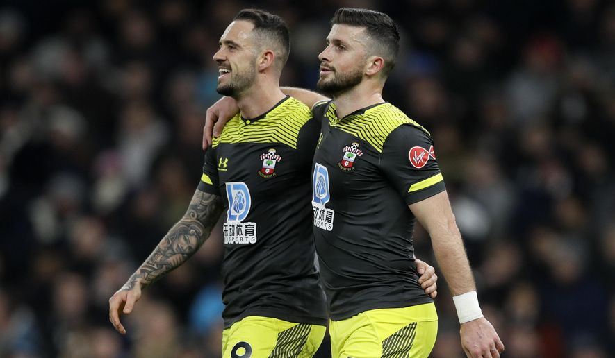 Southampton's Shane Long, right, celebrates with Danny Ings after scoring his side's first goal during the English FA Cup fourth round replay soccer match between Tottenham Hotspur and Southampton at the Tottenham Hotspur Stadium in London, Wednesday, Feb. 5, 2020. (AP Photo/Kirsty Wigglesworth)