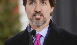 Canadian Prime Minister Justin Trudeau addresses Canadians on the COVID-19 pandemic from Rideau Cottage in Ottawa, Ontario, Wednesday, April 8, 2020. (Sean Kilpatrick/The Canadian Press via AP)