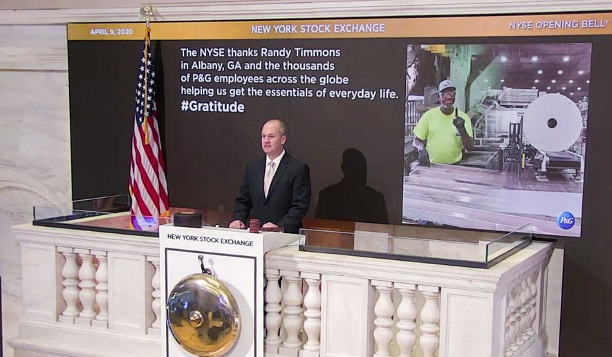 In this photo taken from video provided by the New York Stock Exchange, Chief Security Officer Kevin Fitzgibbons rings the opening bell at the NYSE, while recognizing Randy Timmons in Albany, Ga., and thousands of employees of the Proctor & Gamble Company, Thursday, April 9, 2020. (New York Stock Exchange via AP)