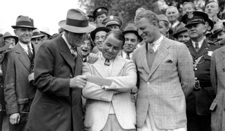 FILE - In this April 8, 1935, file photo, golfer Gene Sarazen, center, receives a check for $1,500 from sportswriter Grantland Rice, left, for winning the Augusta National Invitation Tournament in Augusta, Ga. Sarazen beat Craig Wood, right, to win the tournament. The Masters wasn't even the Masters in 1935. It was the Augusta National Invitation Tournament, the second edition. Craig Wood was the presumed winner, in the clubhouse at 282, until one shot changed everything. (AP Photo/File)