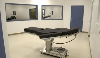 FILE - This Nov. 10, 2016, file photo released by the Nevada Department of Corrections shows the execution chamber at Ely State Prison in Ely, Nev. A nearly two-year fight over drugs that Nevada obtained for an execution it never carried out has ended with pharmaceutical companies taking their expired products back, the state accepting refunds and no clear decision about how a lethal injection could be carried out in the Silver State. State Attorney General Aaron Ford's office and attorneys for two drug companies involved in the case did not immediately comment Thursday, April 9, 2020, about a terse court order issued Tuesday by a judge in Las Vegas dismissing the case that arose from former death row inmate Scott Raymond Dozier's push to be executed. (Nevada Department of Corrections via AP, File)