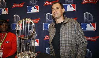 In this Dec. 2, 2019, file photo, Washington Nationals first baseman Ryan Zimmerman poses with the World Series trophy in Washington. With baseball on hold because of the coronavirus pandemic, Zimmerman occasionally will offer his thoughts via diary entries published by the AP, while waiting for the 2020 season to begin. (AP Photo/Patrick Semansky, File)  **FILE**