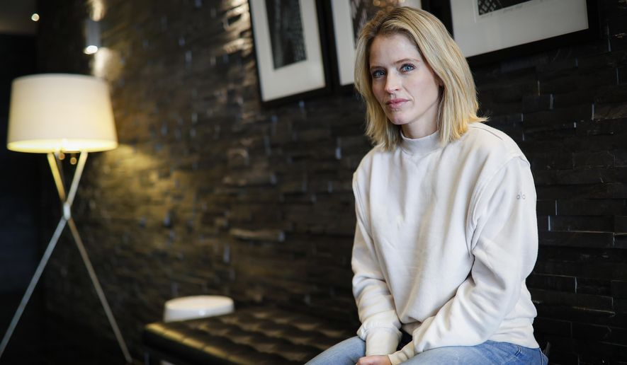 """Television host and journalist Sara Haines is photographed in her lobby after working from home due to COVID-19 concerns, April 6, 2020, in the Brooklyn borough of New York. Haines isn't afraid to tackle serious subjects and has done so often as a co-host on """"The View."""" Monday felt different. Confined to her home, she broadcast a segment from her living room couch about grief, compassion and loneliness. (AP Photo/John Minchillo)"""