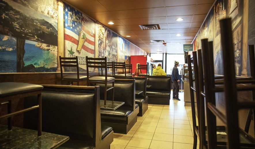 In this March 25, 2020, file photo, the dining section is closed off at East Side Pockets, a small restaurant near Brown University, in Providence, R.I. (AP Photo/David Goldman, File)