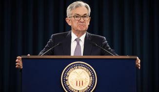 In this Jan. 29, 2020 file photo, Federal Reserve Chair Jerome Powell pauses during a news conference in Washington. (AP Photo/Manuel Balce Ceneta, File) ** FILE **