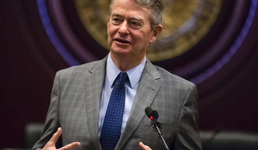 FILE - In this Jan. 3, 2019 photo, Idaho Gov.-elect Brad Little answers a reporter's question at the State Capitol building in Boise, Idaho. The Idaho Department of Labor said Thursday, April 9, 2020, that nearly 78,000 people have filed claims since mid-March. Little issued an emergency declaration on March 13 because of the virus and a statewide stay-at-home order on March 25. (AP Photo/Otto Kitsinger, File)