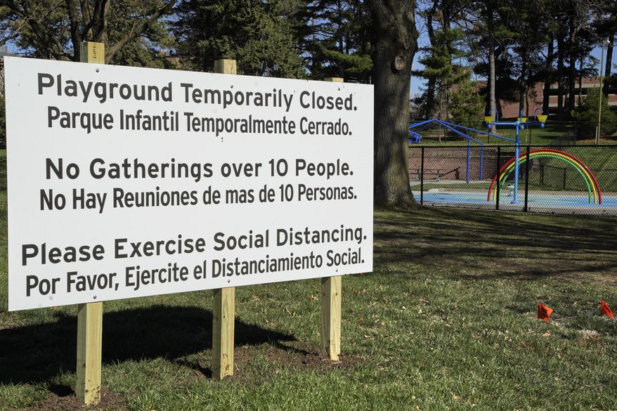 A sign announces the closing of a playground is seen in Omaha, Neb., Thursday, April 9, 2020, as the City of Omaha closes all parks through April 30, 2020, in an effort to combat the coronavirus outbreak. (AP Photo/Nati Harnik)