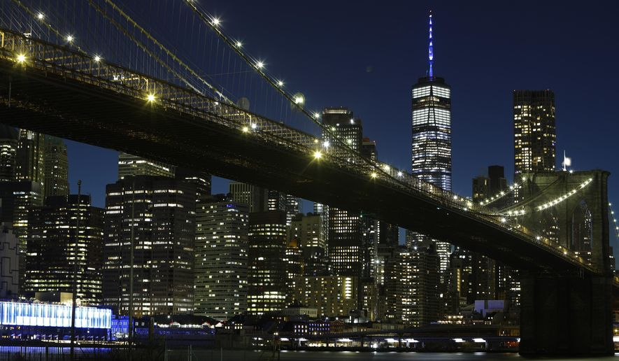 The mast of One World Trade Center is lit in blue to acknowledge essential workers on the front lines of the COVID-19 pandemic Thursday, April 9, 2020, in New York. (AP Photo/Frank Franklin II)