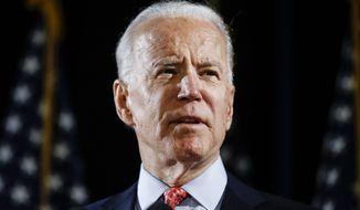In this March 12, 2020, file photo, Democratic presidential candidate former Vice President Joe Biden speaks in Wilmington, Del. (AP Photo/Matt Rourke, File)