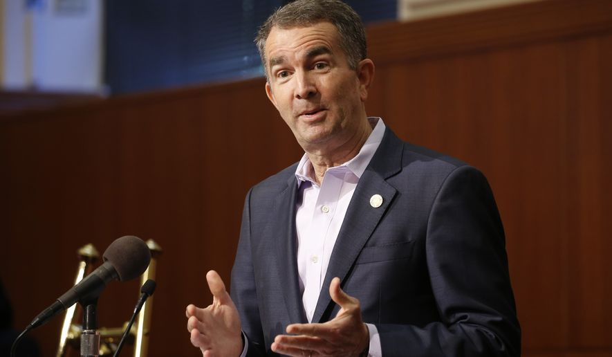 In this April 8, 2020, file photo, Virginia Gov. Ralph Northam gestures during a news conference at the Capitol in Richmond, Va. (AP Photo/Steve Helber, File)