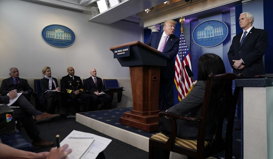President Donald Trump speaks towards Vice President Mike Pence during a coronavirus task force briefing at the White House, Friday, April 10, 2020, in Washington. Seated from left, Director of the National Institute of Allergy and Infectious Diseases Dr. Anthony Fauci, White House coronavirus response coordinator Dr. Deborah Birx, Surgeon General Jerome Adams, and Food and Drug Administration Commissioner Dr. Stephen Hahn. (AP Photo/Evan Vucci)