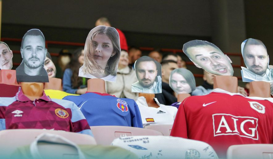 """In this photo taken on Wednesday, April 8, 2020, mannequins in soccer uniforms with the faces of """"virtual fans"""" who bought tickets online are seen on grandstand seats during the match between FC Dynamo Brest and FC Shakhter Soligorsk in Brest, Belarus. Belarus is the last country in Europe still hosting pro sports in front of spectators amid the coronavirus pandemic, but attendances are shrinking as fans decide the stadium is too risky. (Alexey Komelkov, FC Dynamo Brest via AP)"""