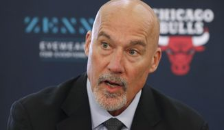 FILE - In this June 24, 2019, file photo, Chicago Bulls executive vice president of basketball operations John Paxson responds to a question about the team's two draft picks during a news conference in Chicago. The Bulls hired Denver Nuggets general manager Arturas Karnisovas to run their basketball operation, a person familiar with the situation said Thursday night, April 9, 2020. The person, who confirmed reports by several outlets, spoke on the condition of anonymity because the move has not been announced. Paxson was expected to move into an advisory role. (AP Photo/Charles Rex Arbogast, File)