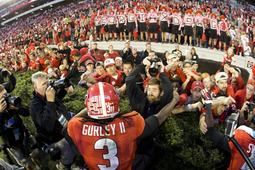 FILE - In this Oct. 4, 2014, file photo, Georgia running back Todd Gurley (3) celebrates with fans after defeating Vanderbilt 44-17 in an NCAA college football game in Athens, Ga. Gurley will be making a homecoming to the state of Georgia when  the former Georgia Bulldogs standout begins the second phase of his NFL career with the Atlanta Falcons. (AP Photo/John Bazemore, File)