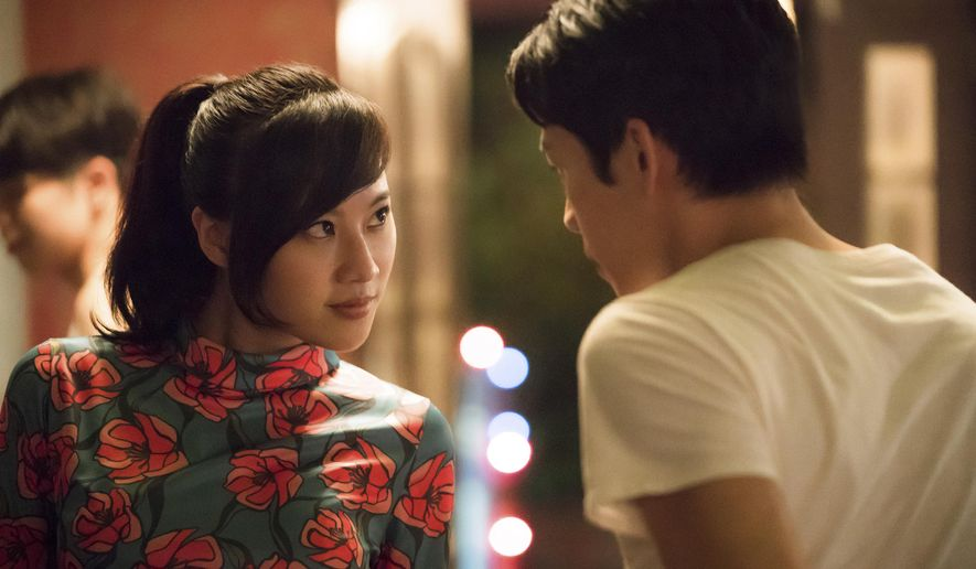 """In this image released by Netflix, Yo-Hsing Fang, left, and Hong Chi Lee appear in a scene from """"Tigerail.""""  (Sarah Shatz/Netflix via AP)"""