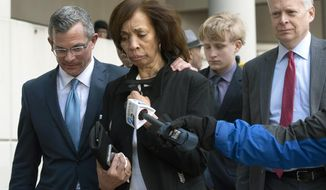FILE - In this Feb. 27, 2020, file photo, former Baltimore mayor Catherine Pugh, second from left, and her attorney Steven Silverman, left, leave a sentencing hearing at U.S. District Court in Baltimore. Pugh's attorney asked a federal judge Wednesday, April 8, 2020, to delay for a second time the start of her prison sentence. (AP Photo/Steve Ruark, File)