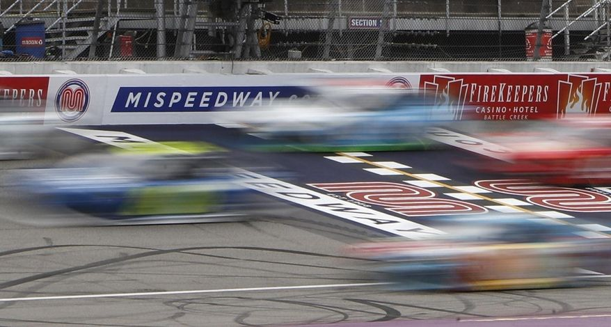 In this June 10, 2019, file photo, drivers race at the NASCAR cup series auto race at Michigan International Speedway in Brooklyn, Mich.(AP Photo/Carlos Osorio, File)  **FILE**