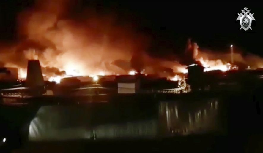 """In this image taken from video provided by Instagram account @incident.38, a fire is blazing at a prison colony where inmates and guards have clashed in Angarsk, 4,000 kilometers (2,500 miles) east of Moscow, Friday, April 10, 2020. Russian officials say a large fire is blazing at a prison in Siberia where inmates and guards have clashed. There was no official information about casualties or damage Friday, but Pavel Glushenko, a local human rights activist, said on social media that """"full-scale hostilities"""" were taking place at the maximum-security prison. (@incident.38 via AP)"""