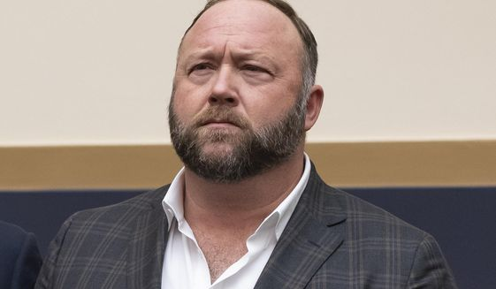 FILE - This Tuesday, Dec. 11, 2018 file photo shows radio show host and conspiracy theorist Alex Jones at Capitol Hill in Washington. On Thursday, April 9, 2020, the U.S. Food and Drug Administration sent a warning letter ordering Jones to stop falsely claiming that toothpaste, mouth wash and other products sponsored by his show can help prevent COVID-19. (AP Photo/J. Scott Applewhite)