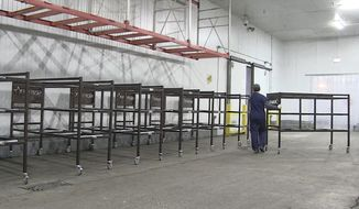 This image from undated video provided by the Office of Cook County Board President shows set-up for the Cook County Medical Examiner's surge center in Chicago. The county is preparing new places to store bodies from a possible surge that could overwhelm hospital morgues. (Office of Cook County Board President via AP)