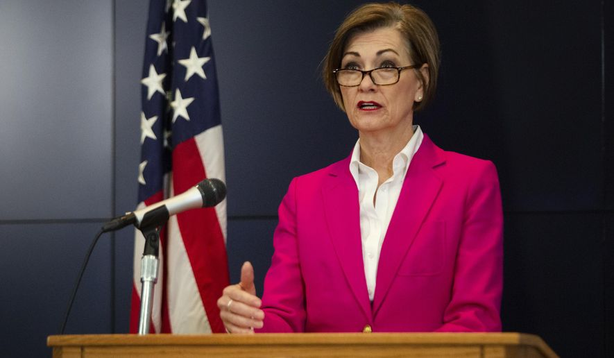 Iowa Gov. Kim Reynolds holds a news conference on COVID-19 at the State Emergency Operations Center in Johnston, Iowa, on Friday, April 10, 2020. (Olivia Sun/The Des Moines Register via AP, Pool)