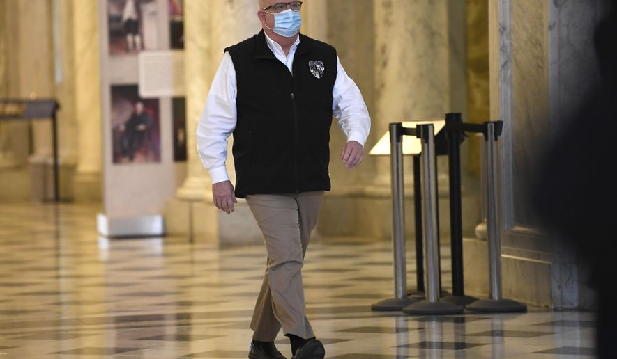 Maryland Gov. Larry Hogan arrives for a news conference in Annapolis, Md., Friday, April 10, 2020. Hogan provided several updates on the state's response to the coronavirus pandemic, including key budget actions and efforts to bolster the process to apply for unemployment. (AP Photo/Susan Walsh)